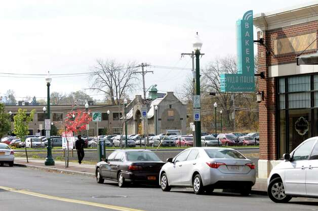 A building that will include 40 apartments is planned for the empty lot between Villa Italia Bakery and the parking lot beyond on Tuesday, Nov. 4, 2014, in Schenectady, N.Y. (Cindy Schultz / Times Union) Photo: Cindy Schultz / 00029349A
