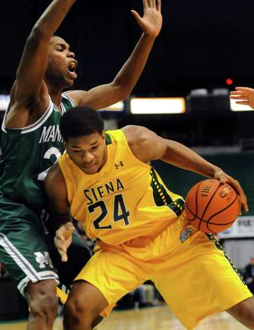 Siena's Lavon Long, right, bumps for room as Manhattan's Rich Williams defends during their basketball game on Friday, Feb. 21, 2014, at Times Union Center in Albany, N.Y. (Cindy Schultz / Times Union) Photo: Cindy Schultz / 00025724A