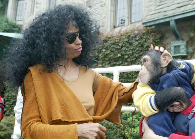 BEVERLY HILLS, CA - OCTOBER 16:  Singer Diana Ross plays with a monkey as she arrives at the 10th Annual Safari Brunch on October 16, 2004 at the Playboy Mansion in Beverly Hills, California. (Photo by Frazer Harrison/Getty Images) Photo: Frazer Harrison, Getty Images / 2004 Getty Images