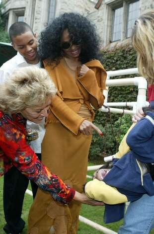 BEVERLY HILLS, CA - OCTOBER 16:  Founder/director of Wildlife WayStation Martine Colette and singer Diana Ross play with a monkey as she arrives at the 10th Annual Safari Brunch on October 16, 2004 at the Playboy Mansion in Beverly Hills, California. (Photo by Frazer Harrison/Getty Images) Photo: Frazer Harrison, Getty Images / 2004 Getty Images