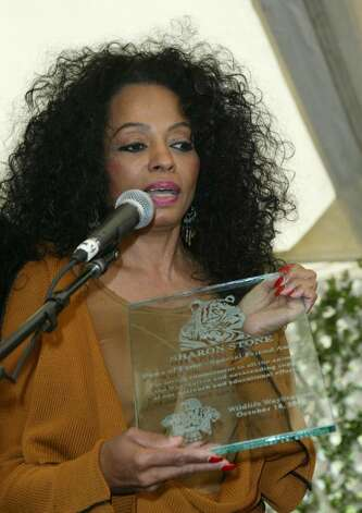 BEVERLY HILLS, CA - OCTOBER 16:  Singer Diana Ross accepts Sharon Stone's award onstage at the 10th Annual Safari Brunch on October 16, 2004 at the Playboy Mansion in Beverly Hills, California. (Photo by Frazer Harrison/Getty Images) Photo: Frazer Harrison, Getty Images / 2004 Getty Images