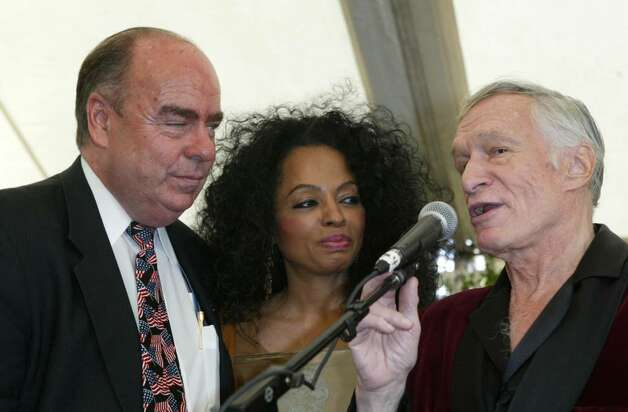 BEVERLY HILLS, CA - OCTOBER 16:  Co-Chairman Arthur Kassel, singer Diana Ross and Hugh Hefner onstage at the 10th Annual Safari Brunch on October 16, 2004 at the Playboy Mansion in Beverly Hills, California. (Photo by Frazer Harrison/Getty Images) Photo: Frazer Harrison, Getty Images / 2004 Getty Images