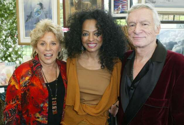 BEVERLY HILLS, CA - OCTOBER 16:  Founder/director of Wildlife Waystation Martine Colette, singer Diana Ross and Hugh Hefner pose inside at the 10th Annual Safari Brunch on October 16, 2004 at the Playboy Mansion in Beverly Hills, California. (Photo by Frazer Harrison/Getty Images) Photo: Frazer Harrison, Getty Images / 2004 Getty Images
