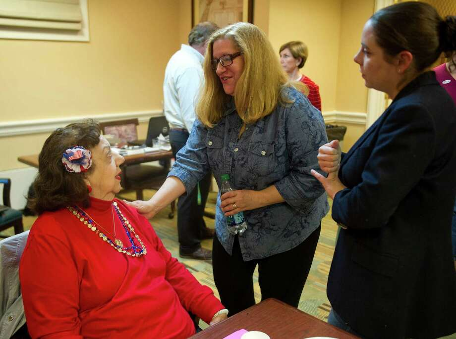 Carol Ann McClean, center, talks with Anne Sessa, left, at the Hampton Inn in Stamford, Conn., on Tuesday, November 4, 2014. Photo: Lindsay Perry / Stamford Advocate