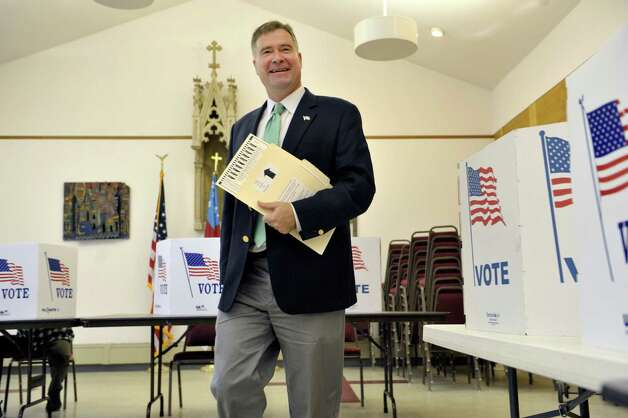 Congressman Chris Gibson walks over to insert his ballot into the voting machine at  St. Paul's Episcopal Church on Tuesday, Nov. 4, 2014, in Kinderhook, N.Y.  (Paul Buckowski / Times Union) Photo: Paul Buckowski / 00029306A