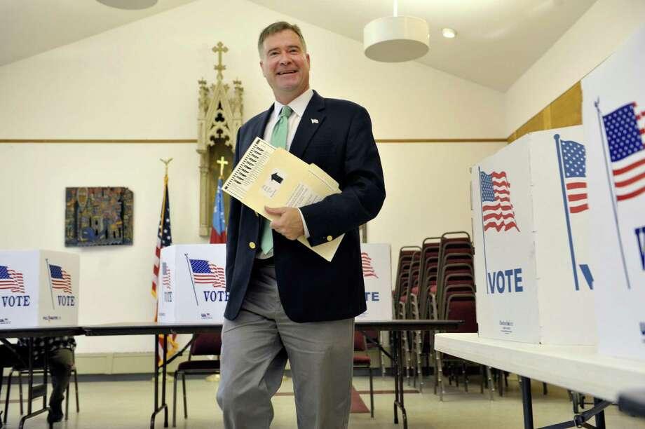 Congressman Chris Gibson walks over to insert his ballot into the voting machine at  St. Paul's Episcopal Church on Tuesday, Nov. 4, 2014, in Kinderhook, N.Y.  (Paul Buckowski / Times Union) Photo: Paul Buckowski / 00029306A