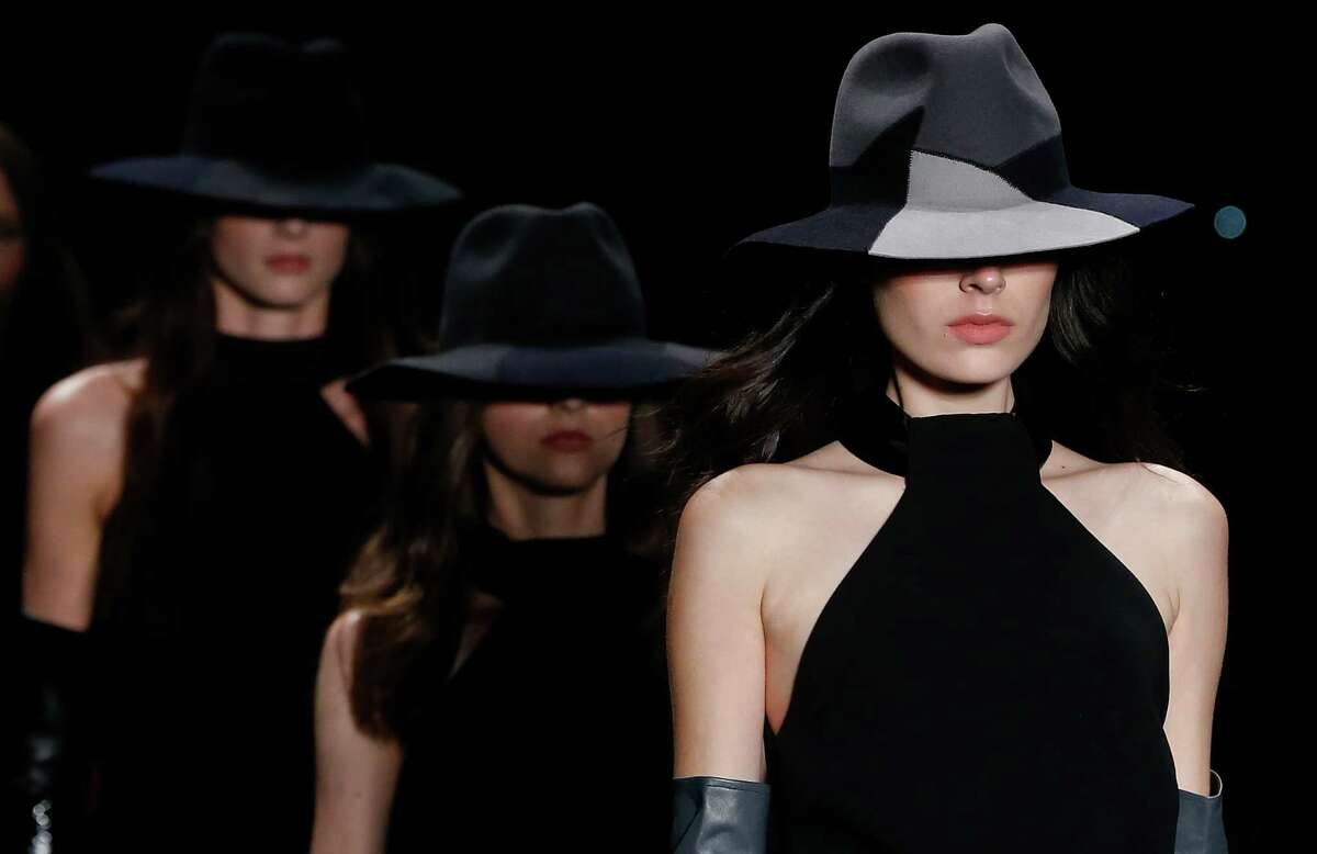 Models wear creations from the Giuliana Romanno Winter collection during the Sao Paulo Fashion Week in Sao Paulo, Brazil, Tuesday, Nov. 4, 2014.