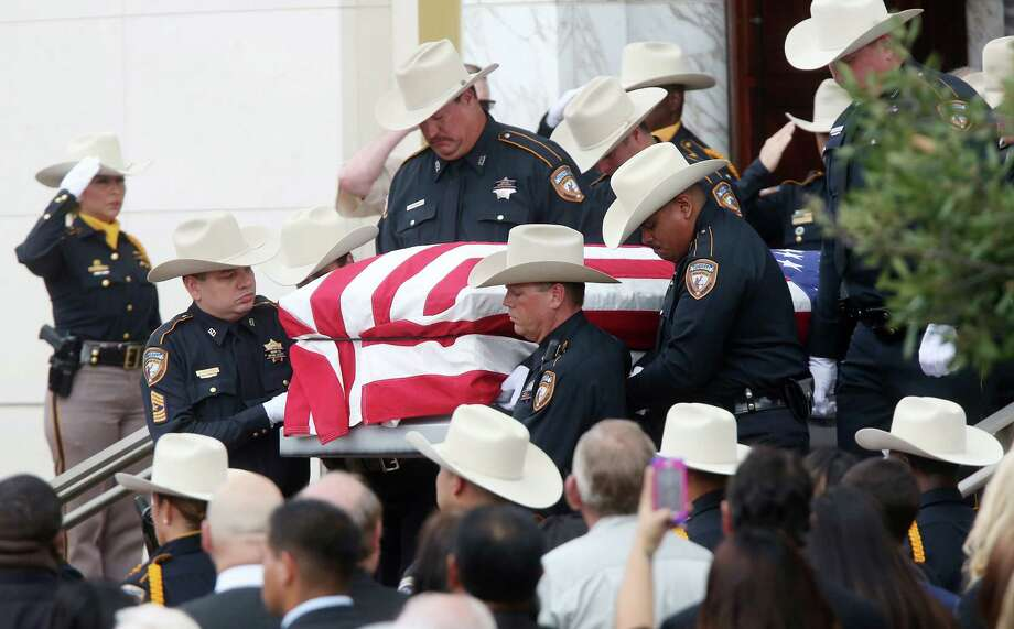 """The white hats of law enforcement were ubiquitous during Tuesday's services in Houston for fallen Harris County Sheriff's Deputy Jesse """"Trey"""" Valdez III. Photo: Mayra Beltran, Staff / © 2014 Houston Chronicle"""