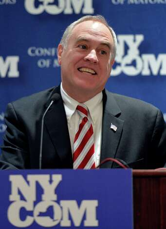 New York State Comptroller Thomas DiNapoli addresses the New York Conference of Mayors Monday morning Feb. 10, 2014 on his 60th birthday at the Albany Hilton in Albany, N.Y.     (Skip Dickstein / Times Union) Photo: SKIP DICKSTEIN / 00025692A