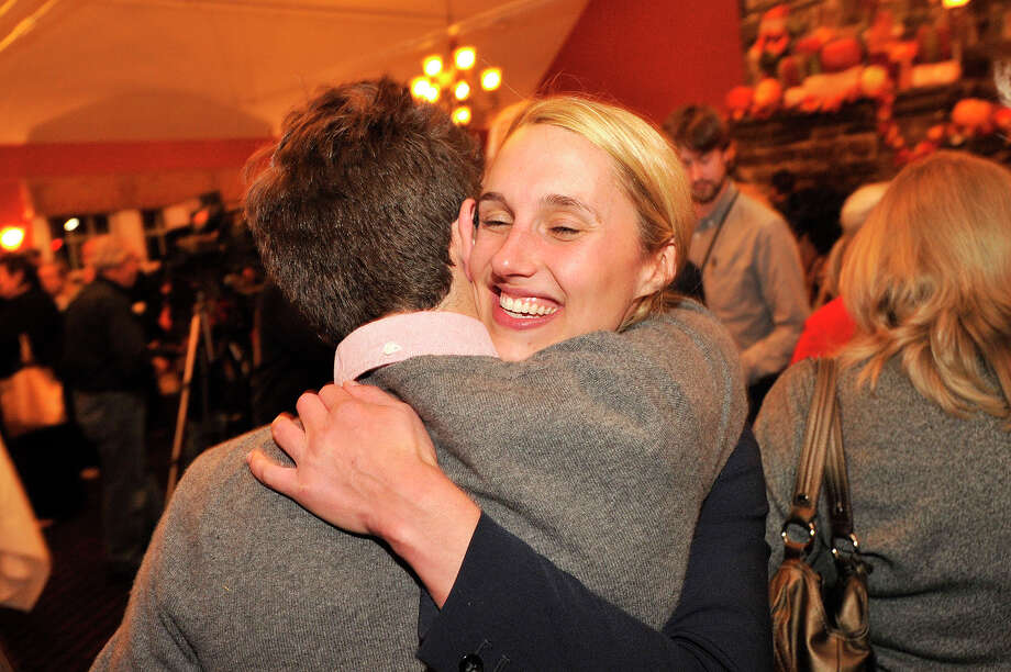 Caroline Simmons, a candidate for State Representative in the 144th District, hugs her field director Harrison Nantz during the Democrat Party election night celebration at Zody's 19th Hole at E. Gaynor Brennan Golf Course in Stamford, Conn., on Nov. 4, 2014. Photo: Jason Rearick / Stamford Advocate
