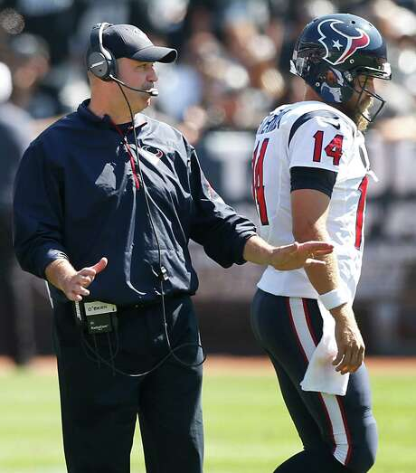 With Ryan Fitzpatrick (14) providing undistinguished play for nine games, a case can be made that it's time for Bill O'Brien, left, to make a switch at quarterback. Photo: Brett Coomer, Staff / © 2014  Houston Chronicle