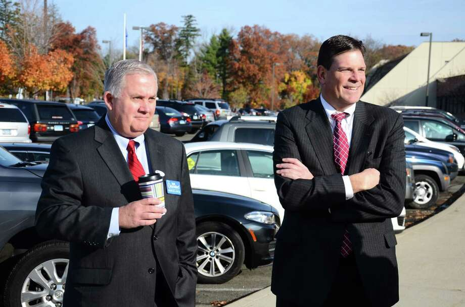 New Canaan Republicans William Osterndorf, left, and Tom O'Dea stand outside the New Canaan High School polling station Tuesday morning. Osterndorf, a New Canaan lawyer,ran  unopposed for judge of the New Canaan-Darien Probate District. O'Dea, an attorney and former member of the Town Council, was challenged by Green Party candidate and New Canaan resident David Bedell. Photo: Nelson Oliveira / New Canaan News
