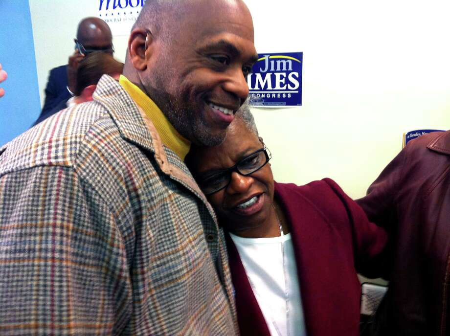 State Rep.-elect Andre Baker and newly-elected state Sen. Marilyn Moore share a congratulatory hug from  at Moore's campaign headquarters on Wood Ave. in Bridgeport, Conn. on Nov. 4, 2014. Photo: Brian Lockhart / Connecticut Post