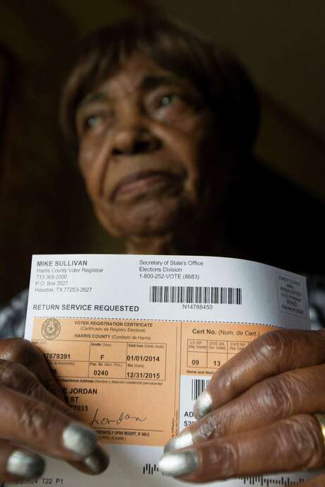 Adlean Jordan, 89, poses for a portrait at her home with her voter registration card on Tuesday, Nov. 4, 2014, in Houston. she tried to cast an early ballot, she was turned away for missing the correct photo ID, required by the voter ID legislation.  ( J. Patric Schneider / For the Chronicle ) Photo: J. Patric Schneider, Freelance / © 2014 Houston Chronicle