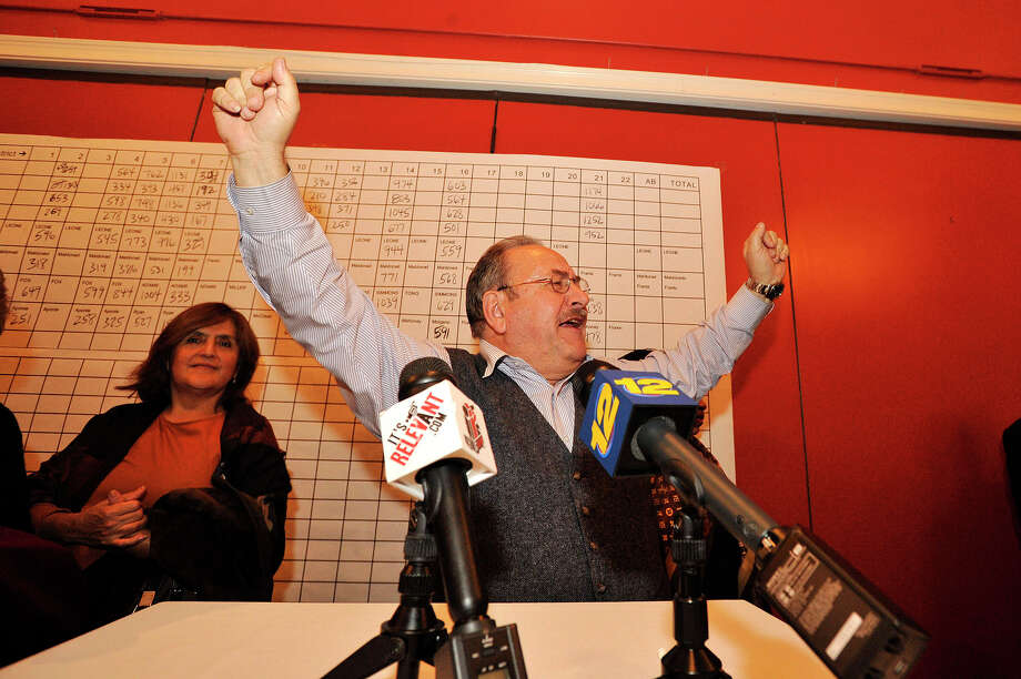 Stamford Democratic Party Chairman John Mallozzi throws his arms in the air while addressing supporters during the Democrat Party election night celebration at Zody's 19th Hole at E. Gaynor Brennan Golf Course in Stamford, Conn., on Nov. 4, 2014. Photo: Jason Rearick / Stamford Advocate
