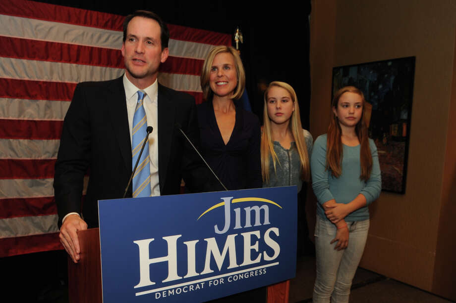 Congressman Jim Himes speaks to supporters at the Holiday Inn in Bridgeport, Conn. Nov. 4, 2014. Himes once again defeated republican challenger Dan Debicella in the 4th Congressional District. Himes is seen here with his wife Mary, and daughters Emma and Linley. Photo: Ned Gerard / Connecticut Post