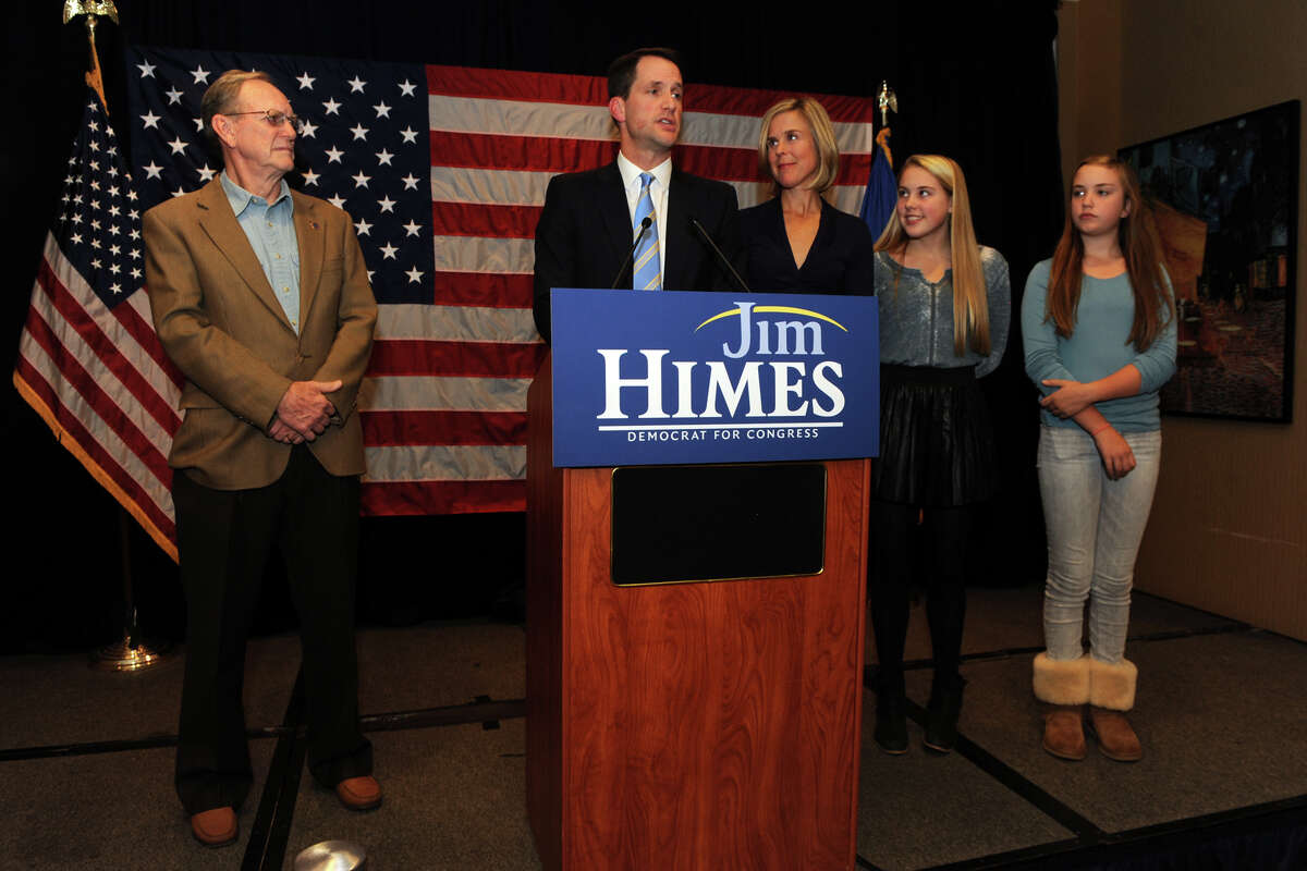 Congressman Jim Himes speaks to supporters at the Holiday Inn in Bridgeport, Conn. Nov. 4, 2014. Himes once again defeated republican challenger Dan Debicella in the 4th Congressional District. Himes is seen here with his father James, wife Mary, and daughters Emma and Linley.