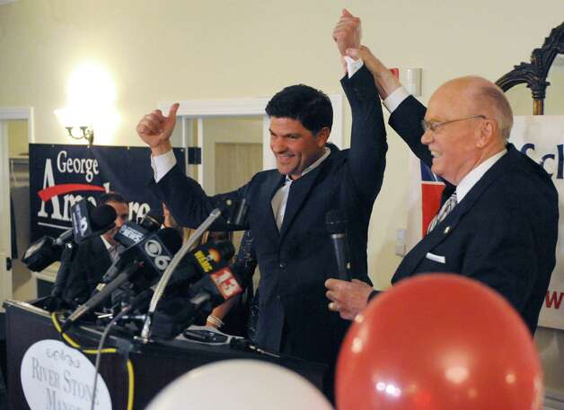 George Amedore, GOP candidate for state senate, and incumbent senator Hugh Farley declare victory in their respective races on Tuesday Nov. 4, 2014 in Glenville, N.Y. (Michael P. Farrell/Times Union) Photo: Michael P. Farrell / 00029327A