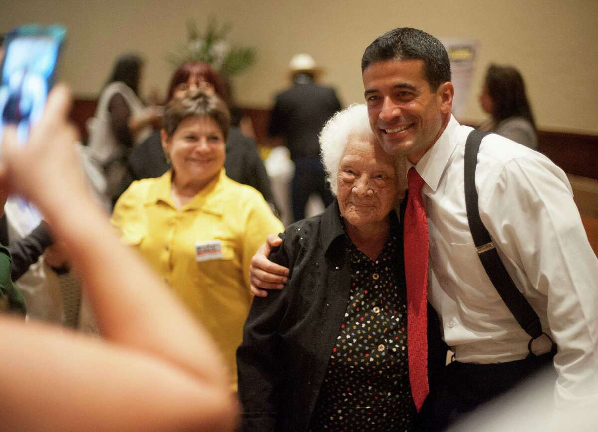 District attorney candidate Nico LaHood, right, poses with 104-year-old supporter, and first-time voter, Ofelia Gonzales, during LaHood's election night event, Tuesday, Nov. 4, 2014, in San Antonio.