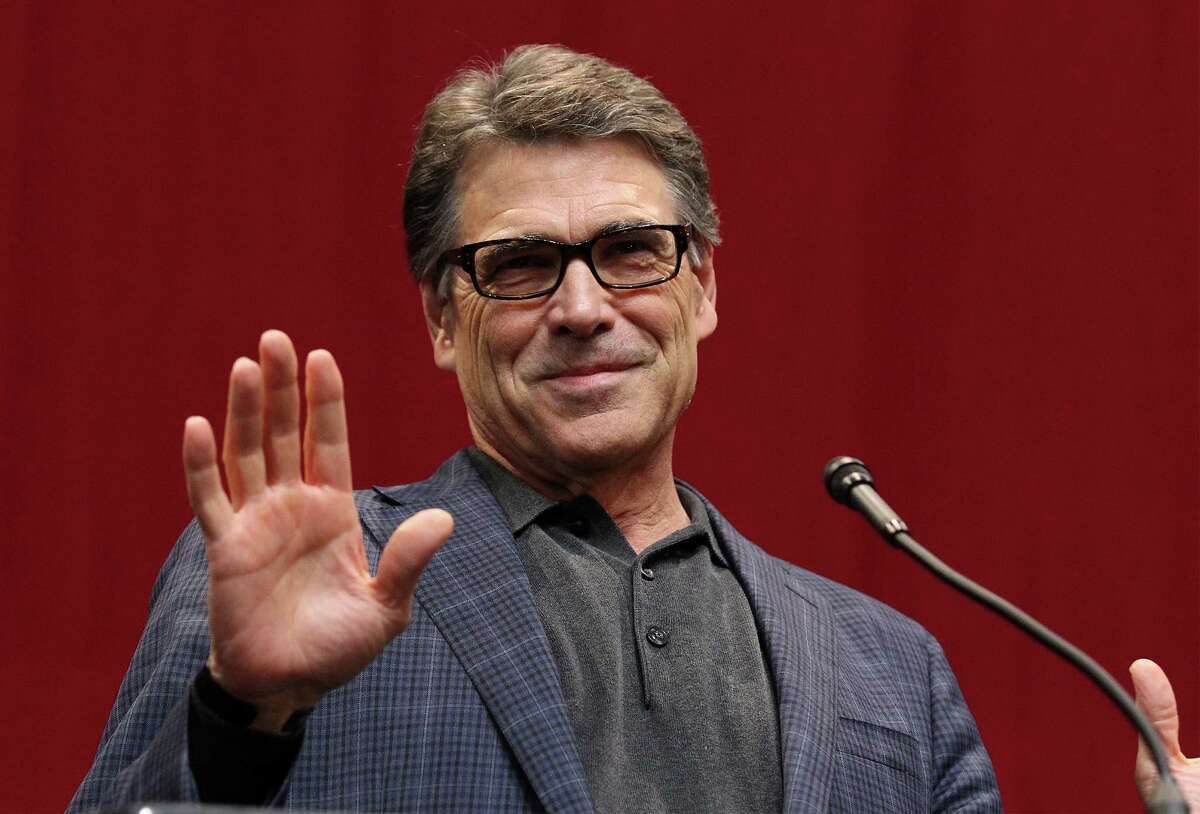Texas Governor Rick Perry acknowledges the audience at the GOP election night party in Austin on Tuesday, Nov. 4, 2014.