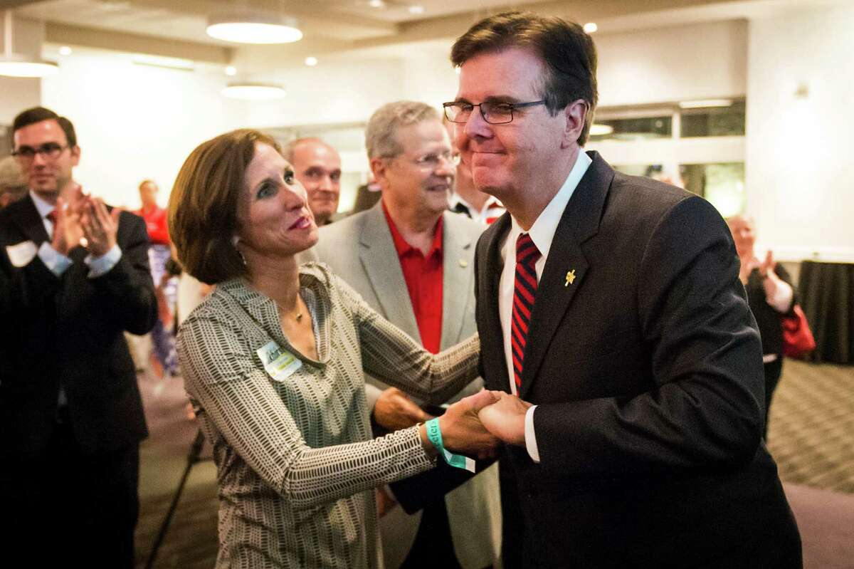 Lt. Gov.-elect Dan Patrick is congratulated by Lois Kolkhorst as he takes the stage to announce victory during an election night watch party in Houston on Tuesday.