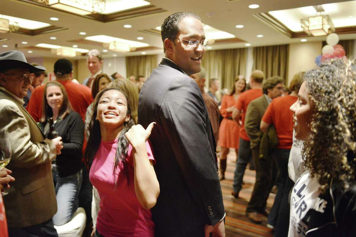 Republican challenger Will Hurd measures his height against his niece Kayla Johnson, during an election night watch party for Will Hurd, a Republican who's challenging U.S. Rep. Pete Gallego, D-Alpine, in U.S. House District 23, at Eilan Hotel Resort and Spa on Tuesday, November 4, 2014.
