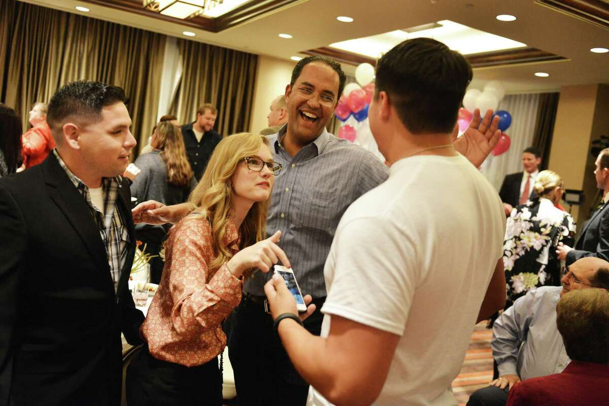 Republican Will Hurd, center, holds a razor-thin lead over Democratic incumbent Pete Gallego in the District 23 race. If elected, Hurd would be the state's first black GOP congressman since Reconstruction.