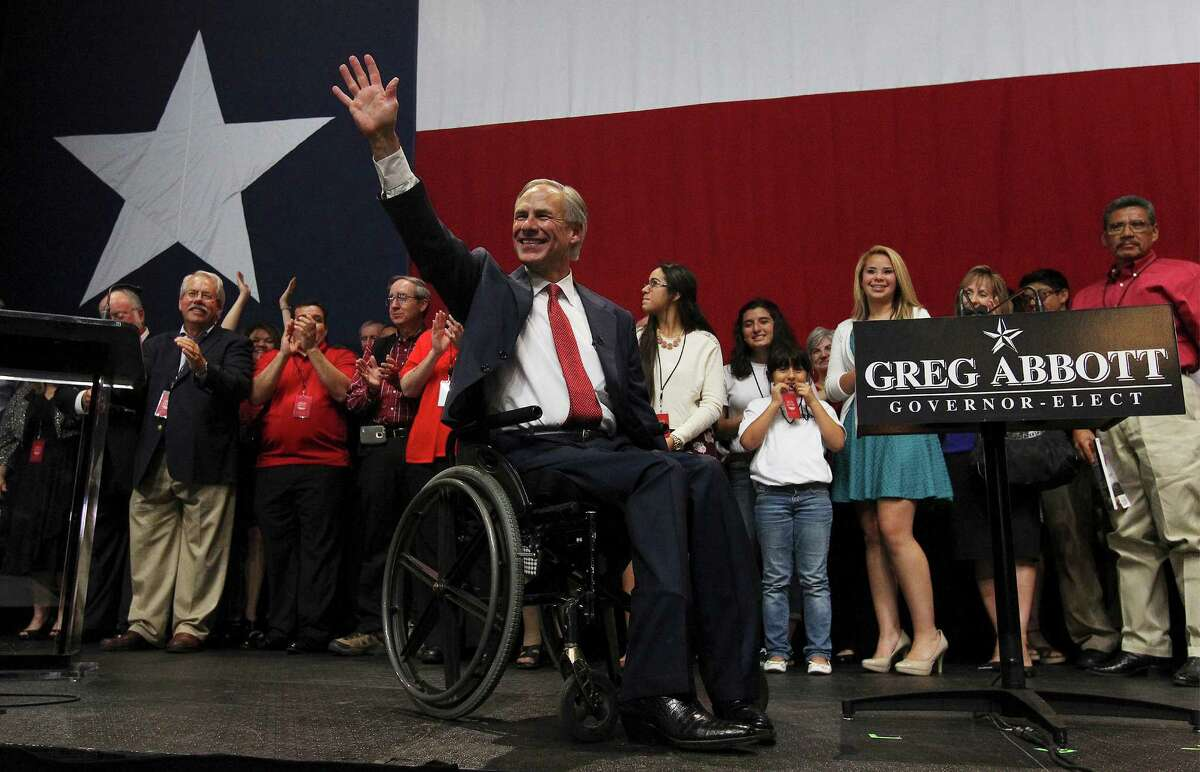Texas Governor elect Greg Abbott waves to the audience at the GOP election night party in Austin on Tuesday, Nov. 4, 2014.