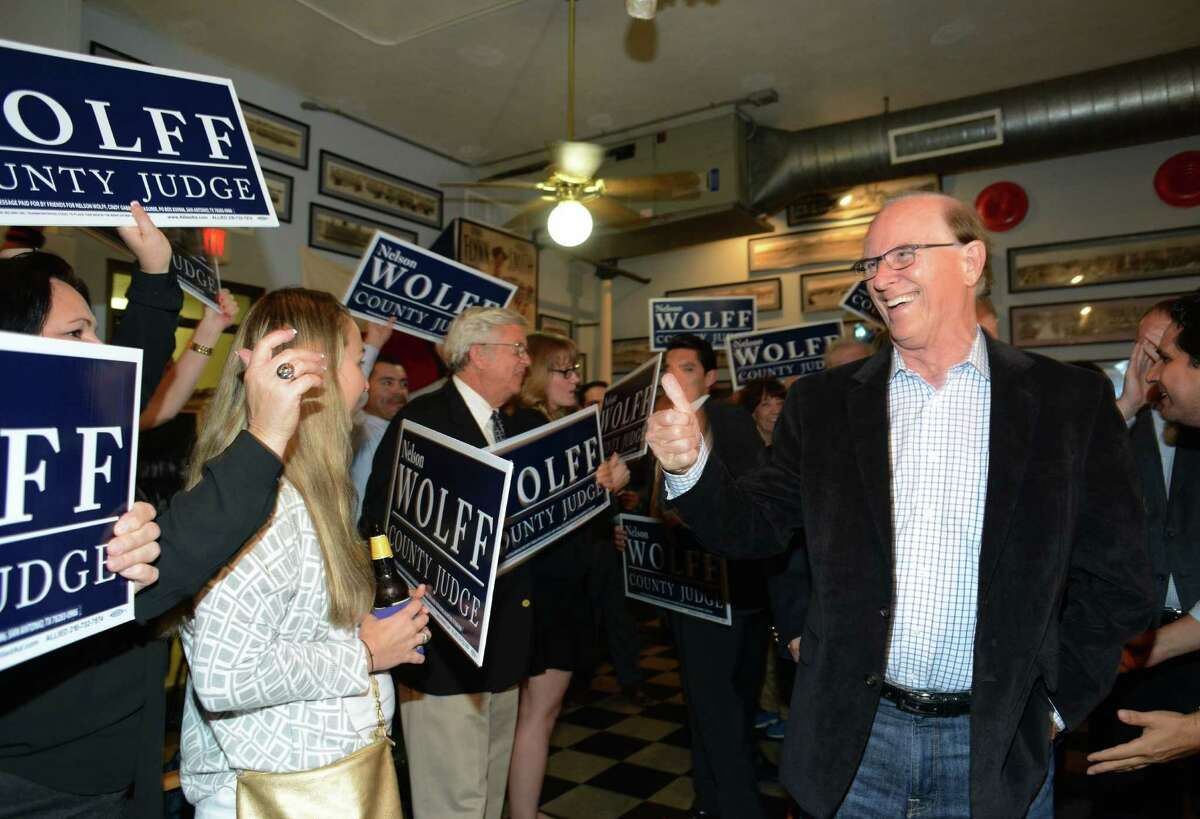 Incumbent Bexar County Judge Nelson Wolff greets supporters during an elections watch party at Wolff headquarters at H B's Deli Tuesday night.