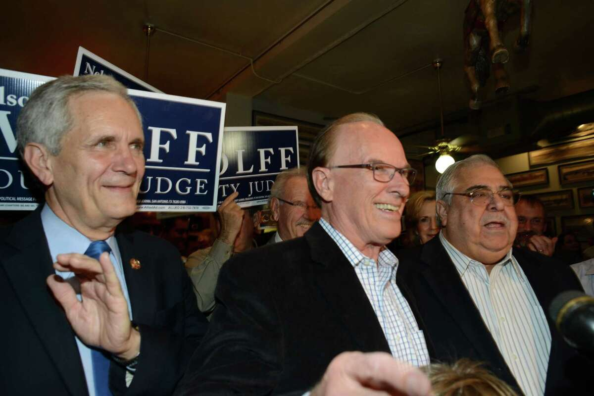 Incumbent Bexar County Judge Nelson Wolff, middle, speaks about having much work to continue to do, as U.S. Rep. Lloyd Doggett, left, and County Commissioner Paul Elizondo, right, stand by at an elections watch party at Wolff headquarters in HB's Deli on Tuesday, Nov. 4, 2014.