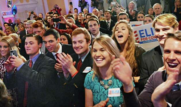 Supporters cheer as Republican Elise Stefanik speaks after winning the 21st Congressional District Tuesday Nov. 4, 2014, in Glens Falls, NY.  (John Carl D'Annibale / Times Union) Photo: John Carl D'Annibale / 00029308A