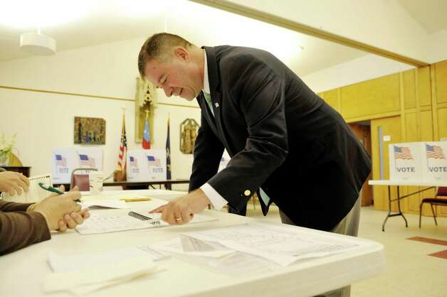 Congressman Chris Gibson signs his name before getting his ballot to vote at  St. Paul's Episcopal Church on Tuesday, Nov. 4, 2014, in Kinderhook, N.Y.  (Paul Buckowski / Times Union) Photo: Paul Buckowski / 00029306A