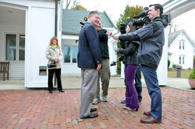 Congressman Chris Gibson talks to the media as his wife, Mary Jo Gibson looks on outside of  St. Paul's Episcopal Church on Tuesday, Nov. 4, 2014, in Kinderhook, N.Y.  (Paul Buckowski / Times Union) Photo: Paul Buckowski / 00029306A