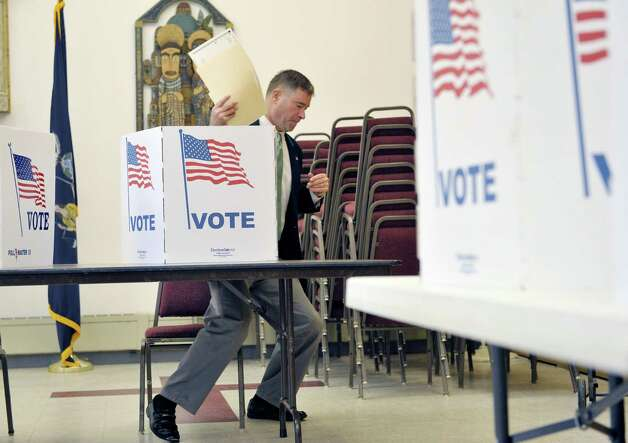 Congressman Chris Gibson gets up after filling in his ballot at  St. Paul's Episcopal Church on Tuesday, Nov. 4, 2014, in Kinderhook, N.Y.  (Paul Buckowski / Times Union) Photo: Paul Buckowski / 00029306A