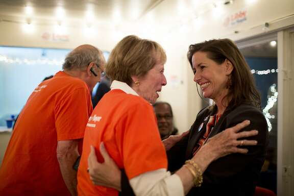 Libby Schaaf shares a moment with her godmother Judy Johnson at the Oakland mayoral candidate's campaign headquarters in Oakland, Calif. on November 4, 2014.