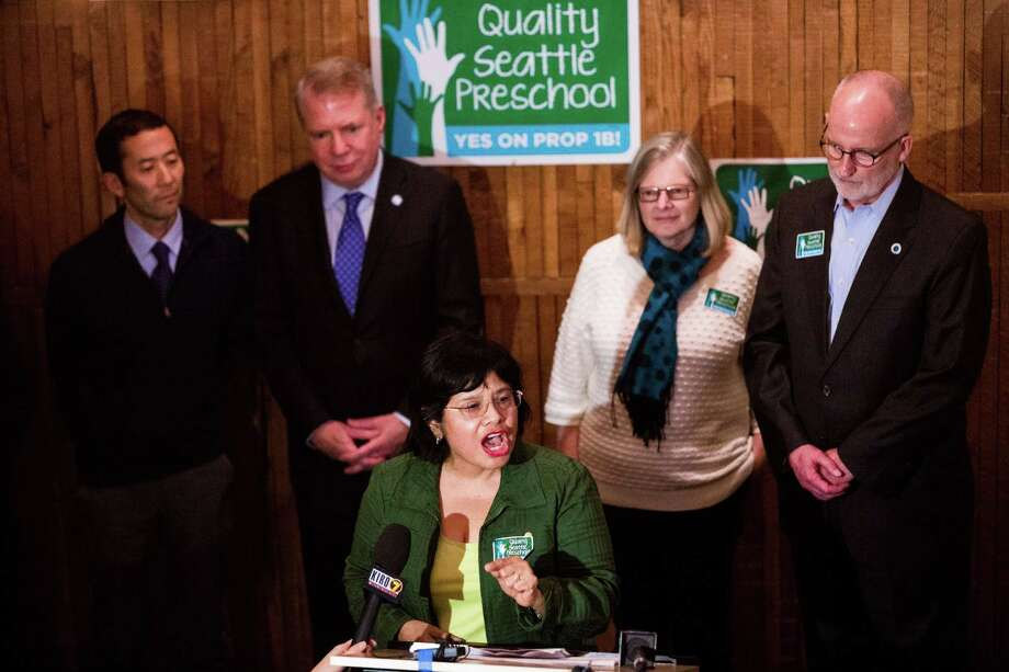 Estela Ortega, center, Executive Director of El Centro de la Raza, celebrates approval of the Seattle Preschool Program by voters in 2014.  The universal preschool pilot program hopes to enroll more than 1,000 four and three-year-olds in the coming school year. Mayor Ed Murray stands in background.. Photo: JORDAN STEAD, SEATTLEPI.COM / SEATTLEPI.COM