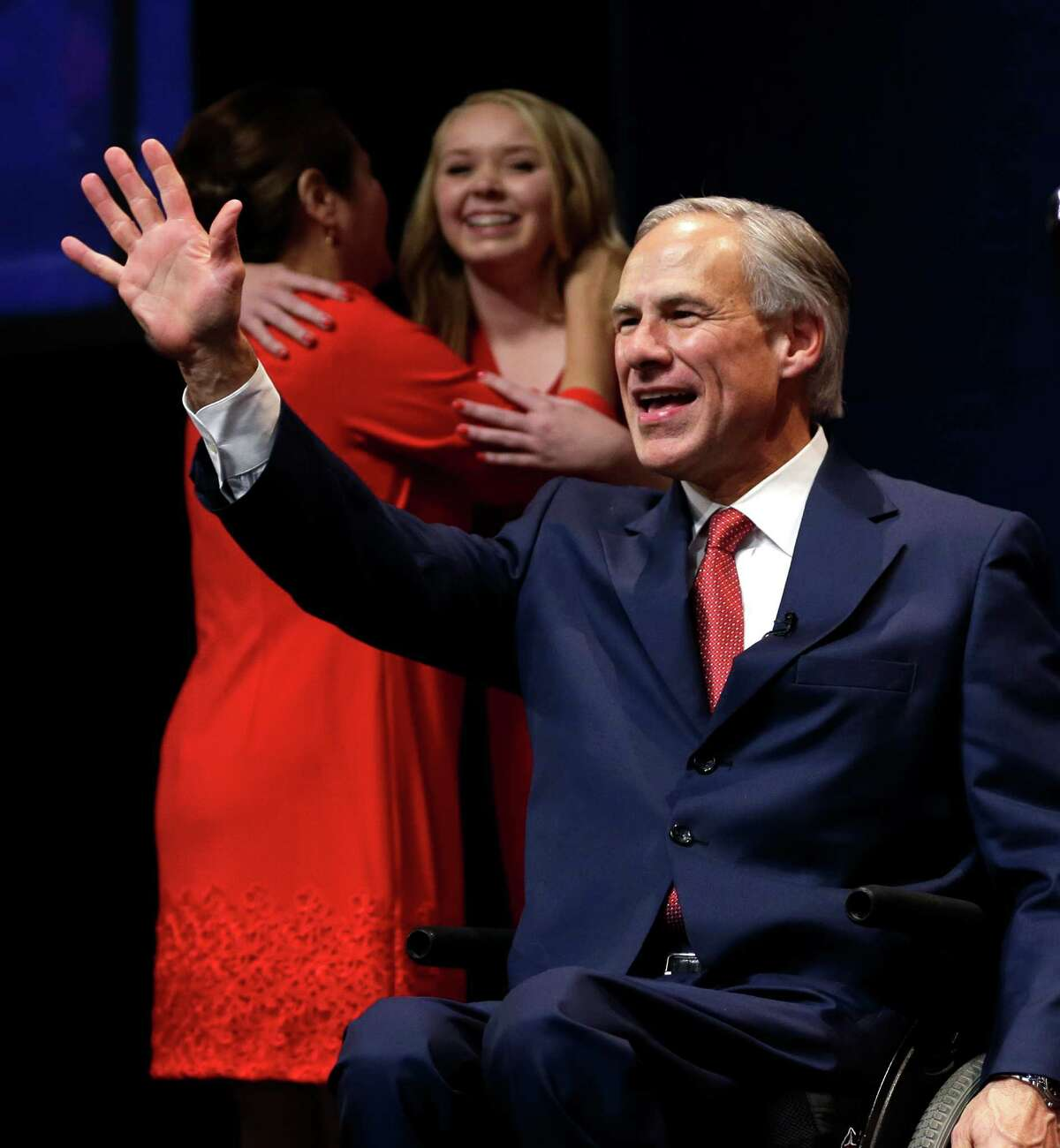 Gov.-elect Greg Abbott waves to the crowd before his victory speech Tuesday in Austin.