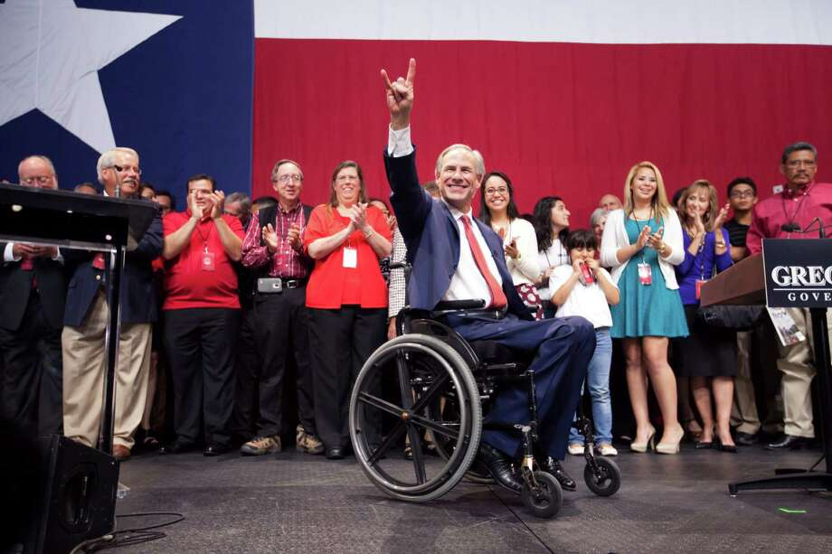 "Attorney General Greg Abbott of Texas, now the stateé¢â'â""¢s governor-elect, flashes a Longhorns symbol at an election night rally in Austin, Nov. 4, 2014. (Michael Stravato/The New York Times) Photo: MICHAEL STRAVATO, STR / NYTNS"