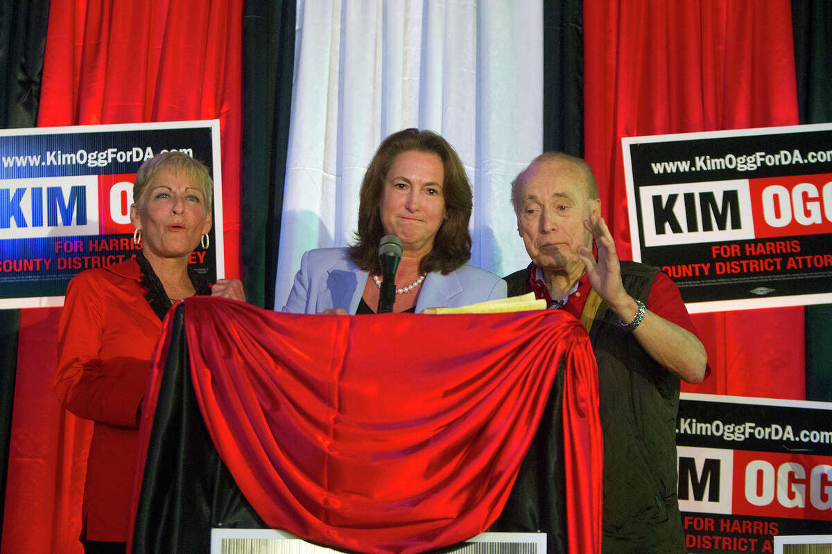 """Kim Ogg concedes with her partner, Olivia Jordan, left, and her father, Jack Ogg, by her side. Even after her loss, Ogg said that the close race showed that Harris County was looking for change and """"change is coming."""""""