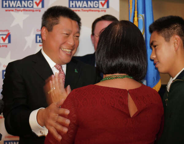 New state senator from the 28th district, Tony Hwang, is congratulated by his wife, Grace, and son, Peter. Photo: Genevieve Reilly / Fairfield Citizen