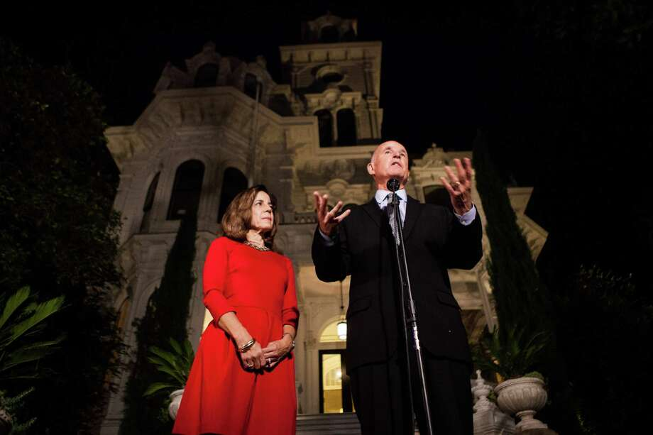 Gov. Jerry Brown, with Anne Gust Brown, speaks to the media after being reelected to a fourth term in front of the Governor's Mansion in Sacramento, California, November 4, 2014. Photo: Max Whittaker/Prime / Special To The Chronicle / ONLINE_YES