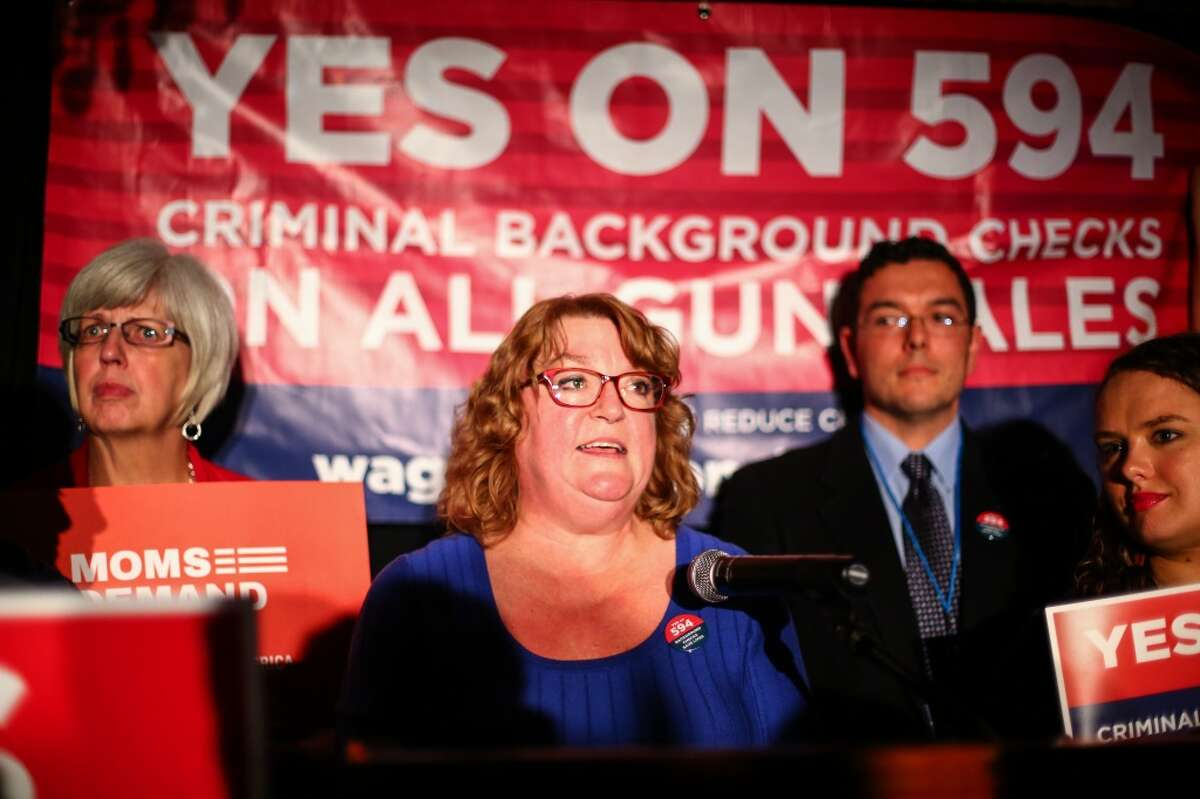 Jewish Federation shooting survivor and initiative backer Cheryl Stumbo takes the podium during an Initiative 594 return watching party at the Edgewater Hotel in Seattle. The initiative will require mandatory background checks for firearms sales. Photographed on Tuesday, November 4, 2014. (Joshua Trujillo, seattlepi.com)