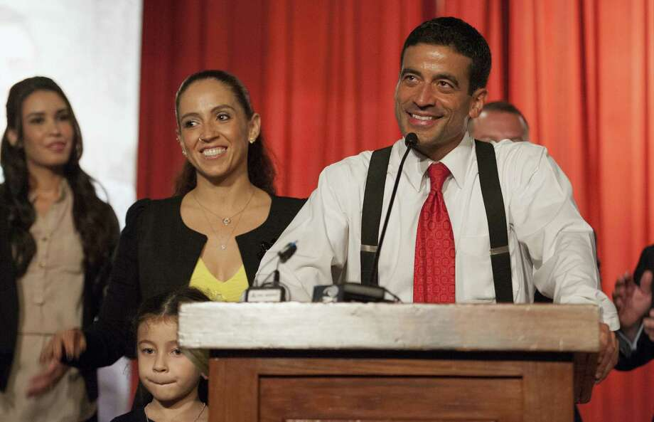 District Attorney-elect Nico LaHood, with wife Davida and 6-year-old daughter Maya, greets supporters during an election night event in San Antonio. Photo: Darren Abate / San Antonio Express-News