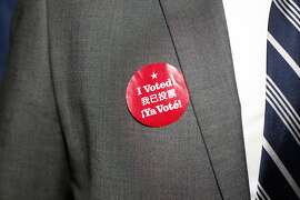"""A detail of an attendee's """"I Voted!"""" sticker is seen at a Propositions A, C, J, K and I watch party at the Julia Morgan Ballroom on November 4, 2014 in San Francisco, Calif."""