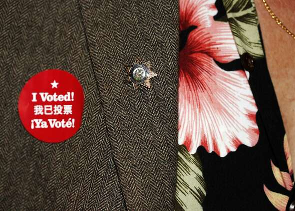 """An attendee sports an """"I Voted"""" sticker at a Propositions A, C, J, K and I watch party at the Julia Morgan Ballroom on November 4, 2014 in San Francisco, Calif."""