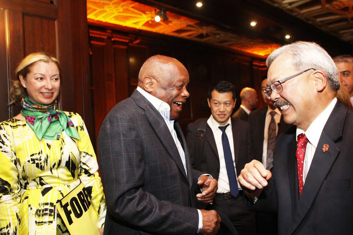 Willie Brown, left, and Ed Lee, right, greet each other at a Propositions A, C, J, K and I watch party at the Julia Morgan Ballroom on November 4, 2014 in San Francisco, Calif. At left is Sonya Molodetskaya.