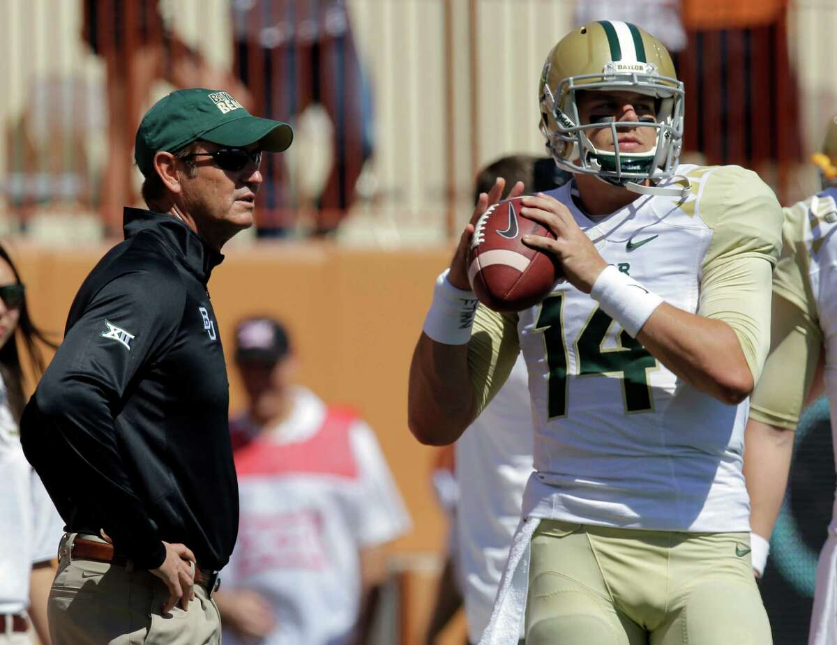 Baylor Bears head coach Art Briles talks with quarterback Bryce Petty before the Texas game on Oct. 4.