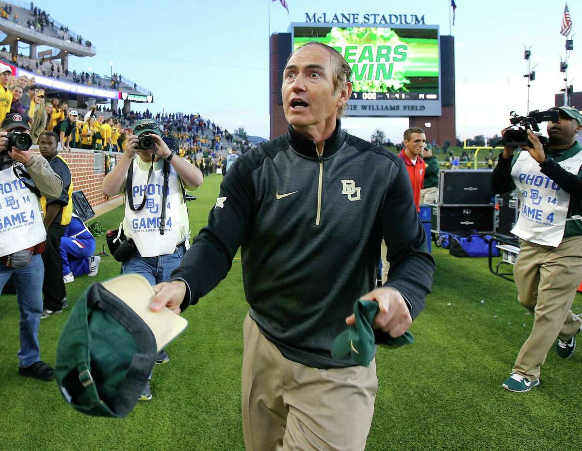 Baylor head coach Art Briles heads toward the student section to toss them a autographed game winning cap after defeating Kansas 60-14 on Nov. 1.