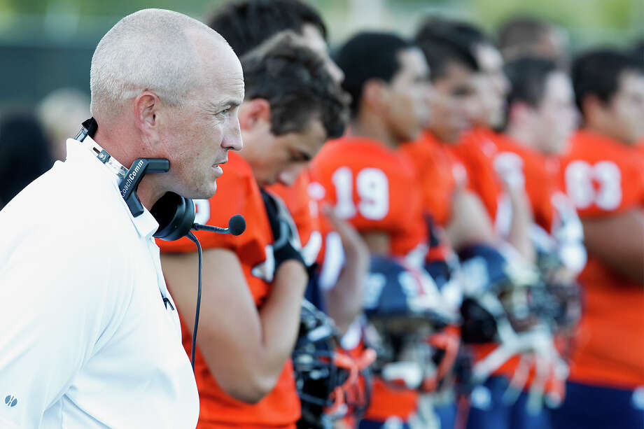 Brandeis coach John Campbell and the Broncos stand at attention as the national anthem in sung prior to their game with Johnson at Farris Stadium on Sept. 7, 2013. Photo: Marvin Pfeiffer /San Antonio Express-News / Express-News 2013