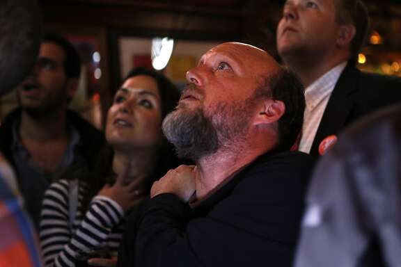 Proposition E campaign manager Todd David watches voting results at Valley Tavern on 24th Street in San Francisco, Calif., on Tuesday, November 4, 2014.